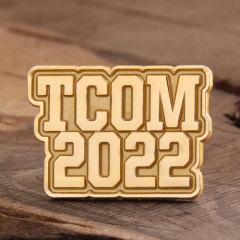 TCOM Enamel Pins